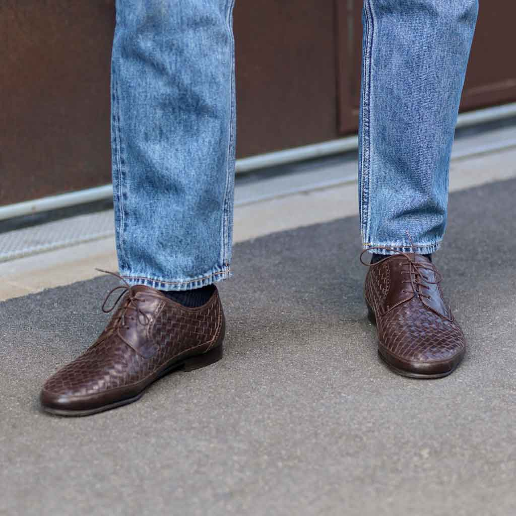 Brown woven shoes and jeans