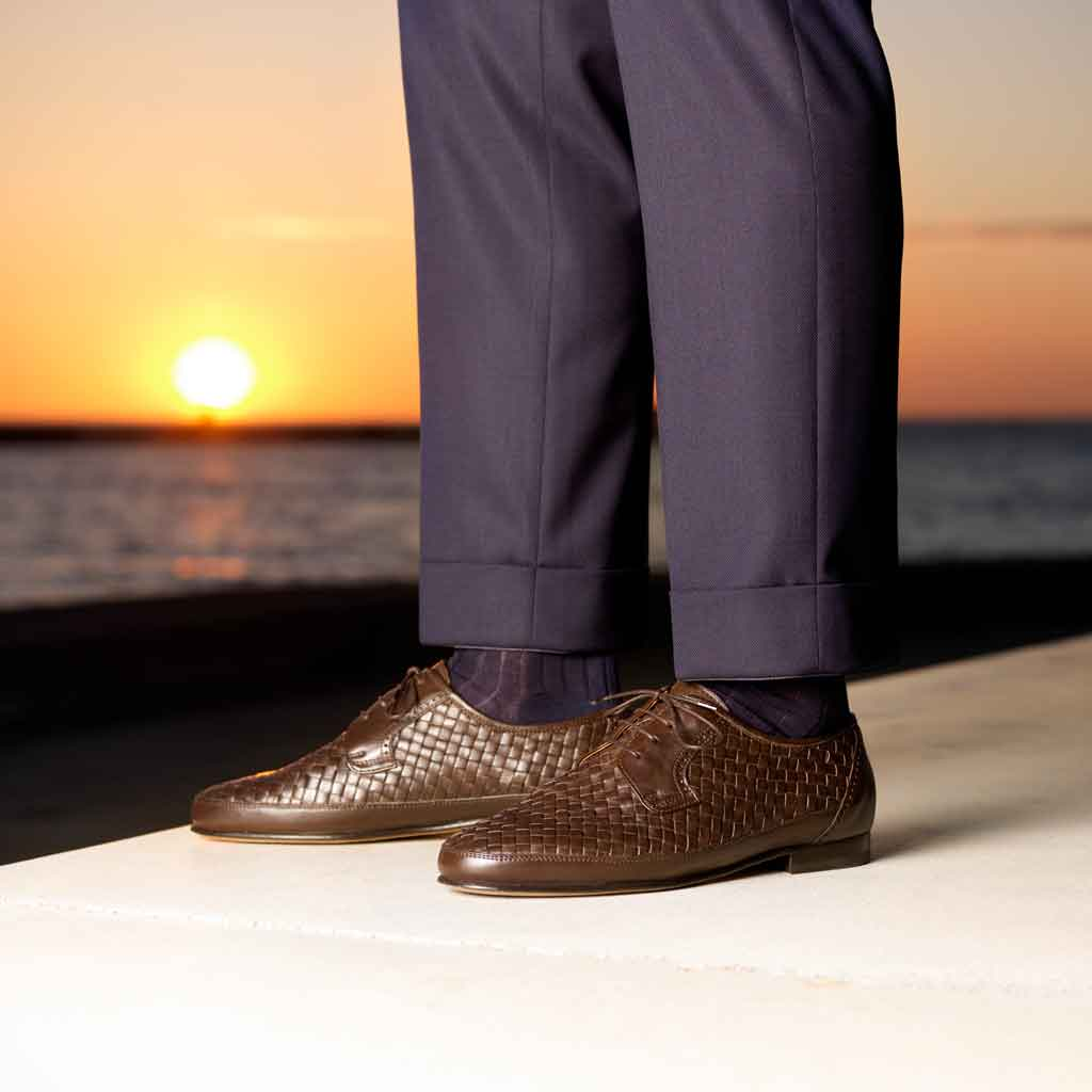 Woven leather shoes and blue suit