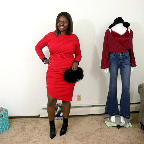 Black woman red dress black boots and black purse