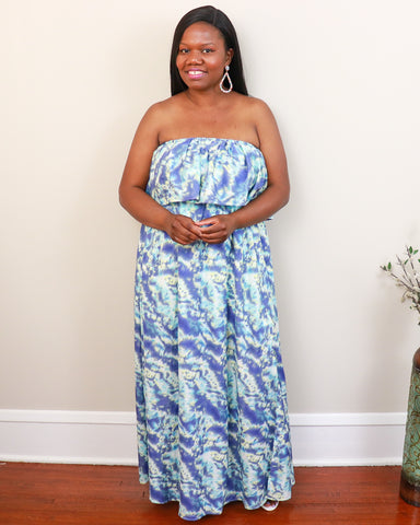 Black woman strapless wearing blue and mint maxi dress