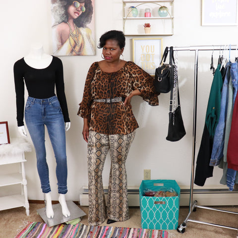 Leopard print bell sleeve blouse snakeskin print wide leg pants black woman mannequin black bodysuit and skinny jeans