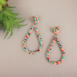 Multi-colored pair-shaped beaded earring. Three inch length.