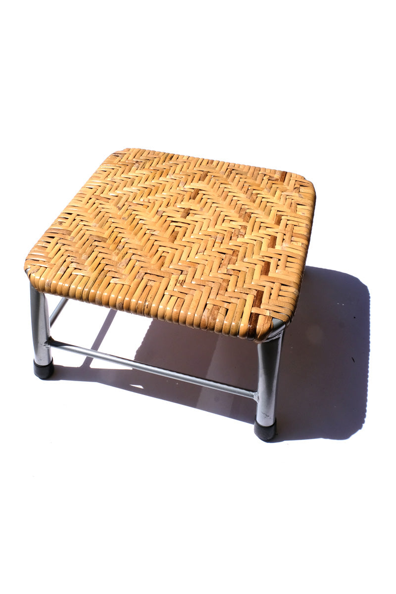 rattan stool - grey metal legs
