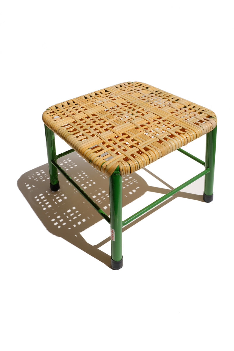 rattan stool - green metal legs