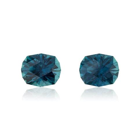 """Pair of modified cushion-cut Montana sapphires totaling 6.90 carats titled, """"Thing 1 & Thing 2,"""" by Jeff Hapeman, Somewhere In The Rainbow."""