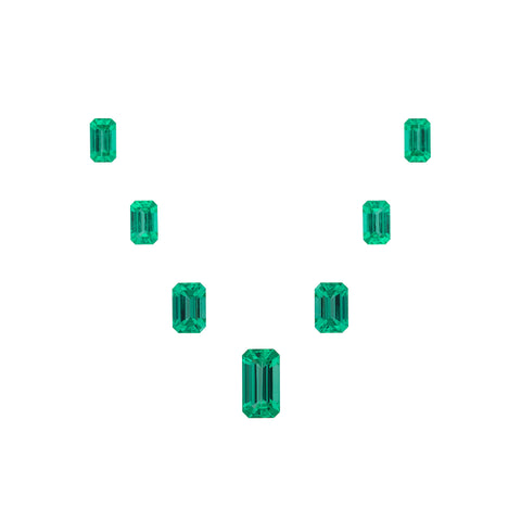 Suite of step-cut emeralds totaling 8.64 carats by Mikola Kukharuk, Nomad's.