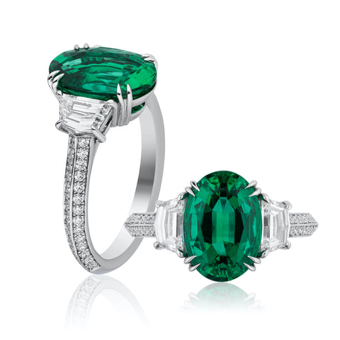 Ring featuring a 3.38-carat oval-shaped emerald accented with diamond epaulets totaling 1.00 carat set in platinum by Niveet Nagpal, Omi Privé.