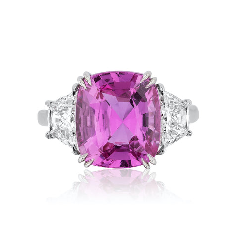 Ring featuring a 7.23-carat cushion-shaped pink sapphire accented with diamonds set in platinum by Joseph Ambalu, Amba Gem Corp.