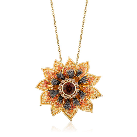 """Brown-Eyed Susan"" pendant featuring a 5.30-carat orange Montana sapphire accented with orange and yellow sapphires totaling 8.69 carats and black and cognac diamonds totaling 1.98 carats set in 18-karat yellow gold by Paula Crevoshay, Mellika Company, Inc./ Crevoshay."