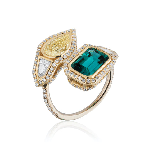 Ring featuring a 2.39-carat untreated blue tourmaline and a 1.03-carat fancy yellow diamond accented with round- and bullet-cut diamonds totaling 1.14 carats set in 18-karat white and yellow gold by Raja Mehta, A. G. Gems, Inc.