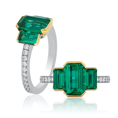 Ring featuring three untreated emerald-cut Colombian emeralds totaling 2.48 carats accented with diamonds set in platinum and 18-karat yellow gold by Oren Nhaissi, EMCO Gem, Inc.