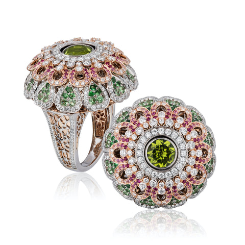 """Chameleon"" ring featuring a 3.55-carat rhodolite garnet and a 2.10-carat peridot accented with tsavorite garnets totaling 1.88 carats, pink sapphires totaling 0.70 carat and diamonds totaling 2.07 carats set in 18-karat white and rose gold by Tariq Riaz, Tariq Riaz LLC. The ring features a mechanism that switches the center gem."