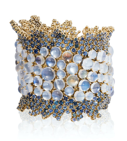 """Moon Dance"" bracelet featuring rainbow, blue flash, silver flash and cat's eye moonstones totaling 133.19 carats accented with sapphires totaling 38.61 carats set in 18-karat yellow gold by Paula Crevoshay, Mellika Company, Inc./Crevoshay."