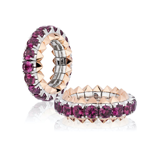 Expandable ring featuring pink rhodolite garnets totaling 5.01 carats set in 18-karat rose and white gold by Tariq Riaz, Tariq Riaz LLC.
