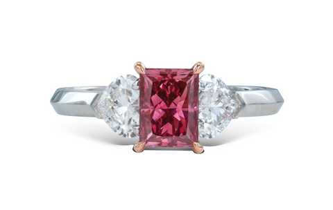 This 1.05-carat fancy purplish-red VS2 diamond set in a ring by Graff sold for $2,640,000 per carat at Christie's, setting a new auction record for price per carat.