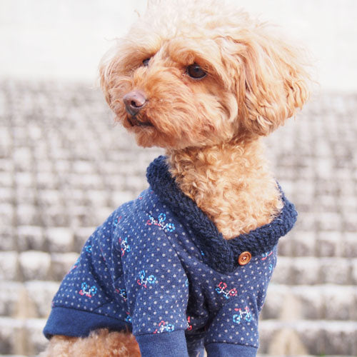 A dog wearing shawl collar tops