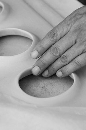 Hand touching ceramic art