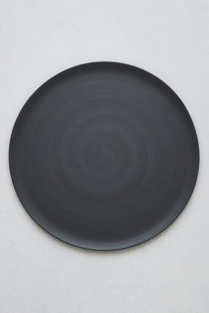 Charger plate in matte black by Rina Menardi