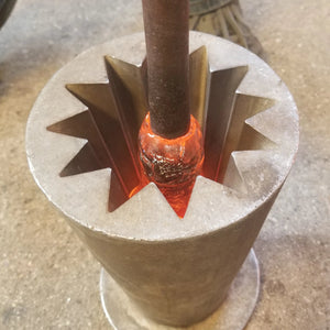 Blowing glass into an optic mold