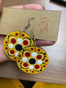 Yellow earrings with white, red and black detail
