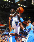 Tyreke Evans Autographed / Signed Vs. Denver Nuggets 16x20 Photo