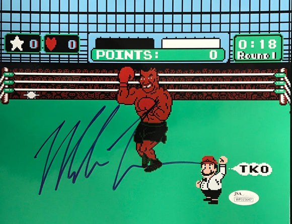 Mike Tyson Autographed Tyson's Punchout 8x10 Photo (JSA)