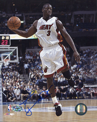 Dwyane Wade Autographed Passing Rookie 8x10 Photo. Signed in blue sharpie across the front of the photo. Authenticity is provided by Rich Altman's Hollywood Collectibles and will be accompanied with a COA from Hollywood Collectibles.