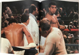 Muhammad Ali Signed Soft Cover Book (Sportscard Guaranty Authentic)