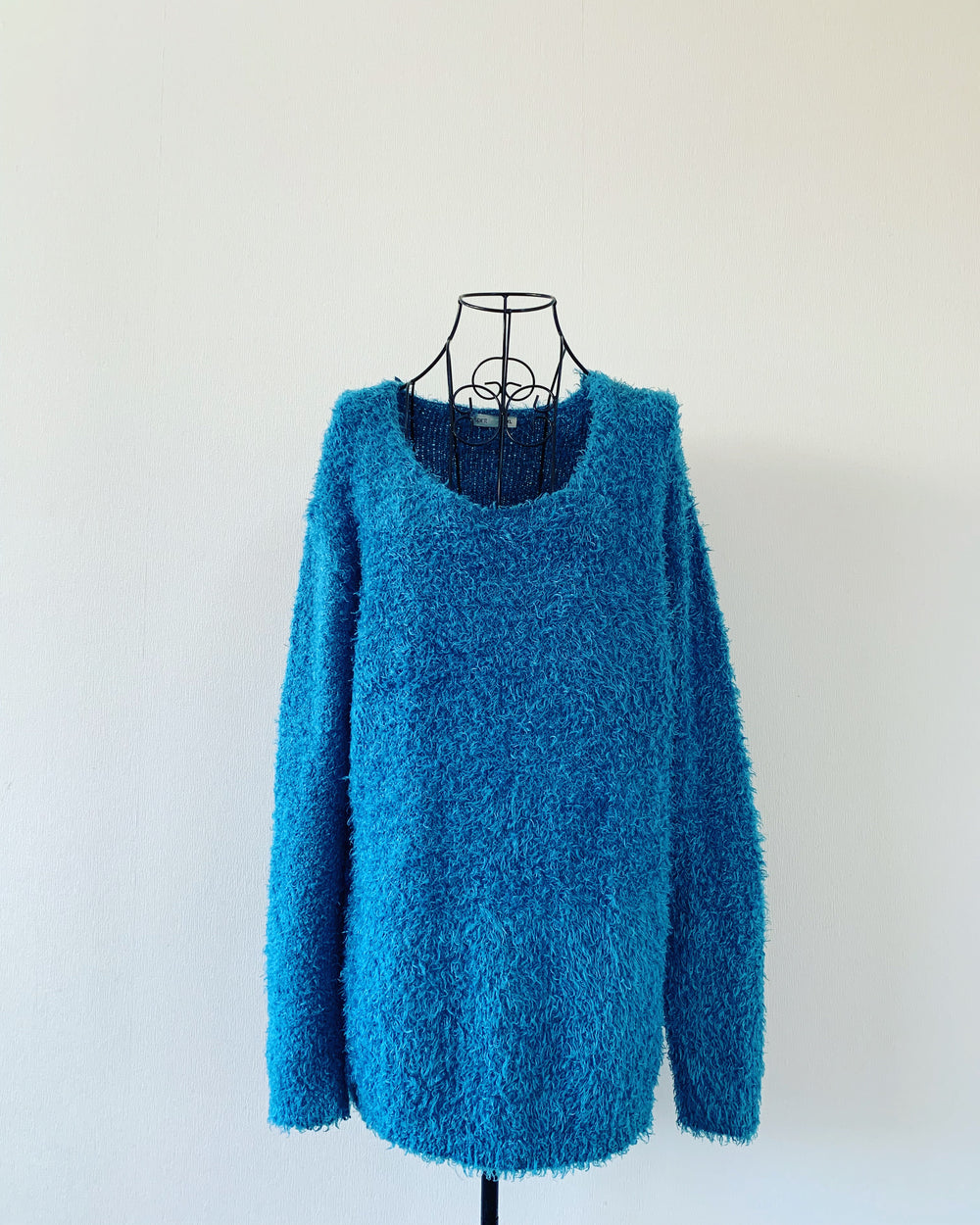 fluffy teal sweater