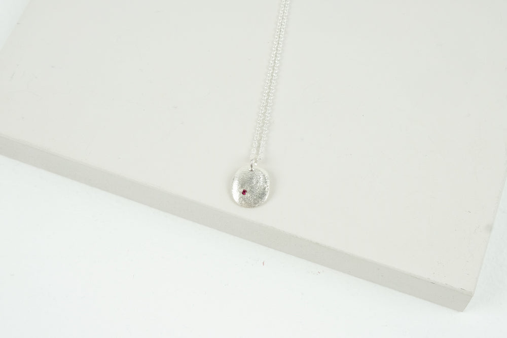 Silver Smoosh Pendant with Ruby