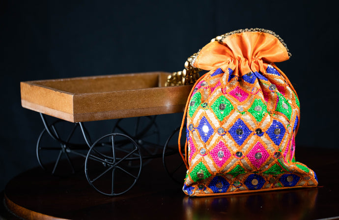 Orange Thread Embroidery Potli