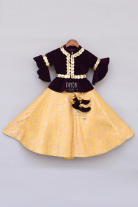 Girls Purple Velvet Peplum Choli With Yellow Brocade Lehenga