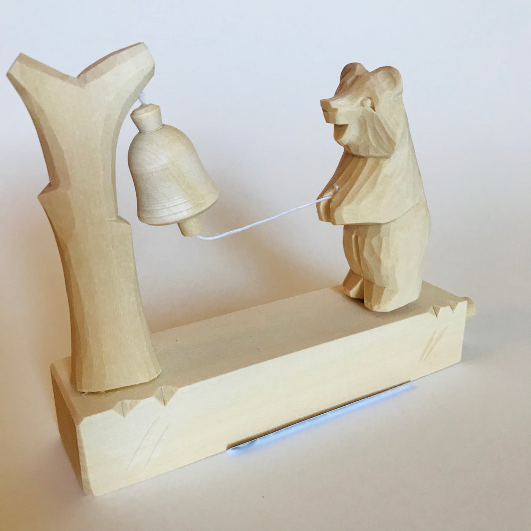 Wooden moving toy - Bear rings bell