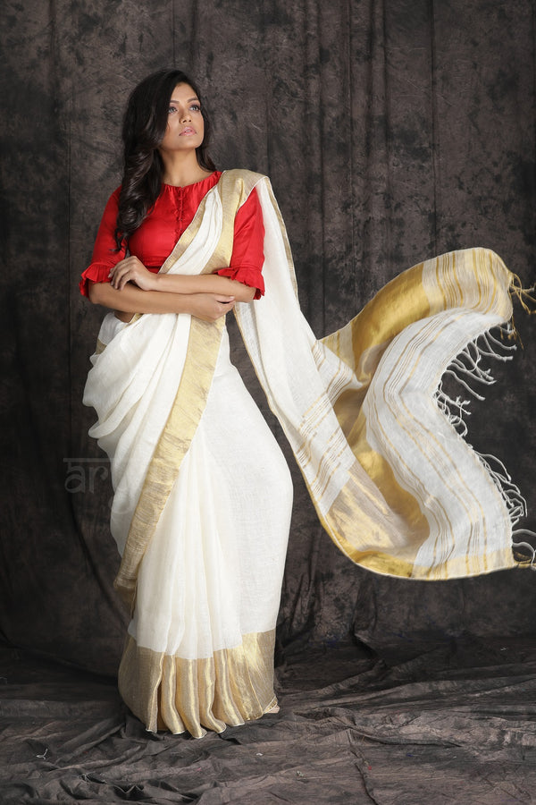 White textured Organic Linen saree with gold Border