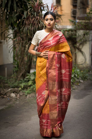 Orange Tussar Silk saree with Lotus Design