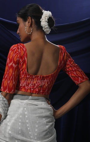 An Ikkat Blouse in a Stunning Combination of Red & Orange