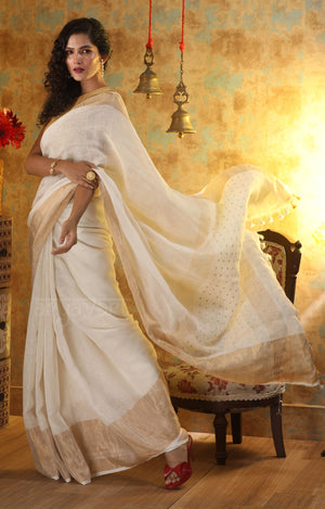 Off-White Organic Linen Saree with Gold Zari Border & Sequence woven into the Pallu