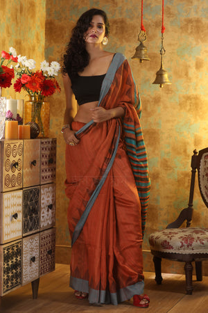 Rusty Orange Matka Silk Saree With Temple Border & Stiped Pallu