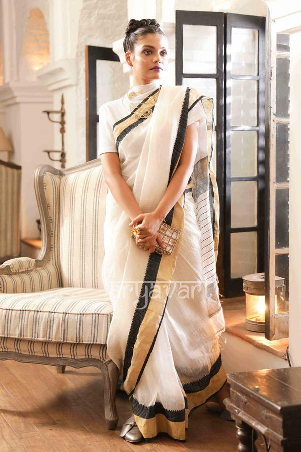 Stunning White Silk- Linen saree with black & Gold Zari Border