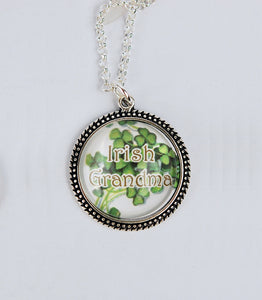 "Pendant of antique silver bezel set sweet shamrocks captured under a dome of crystal clear glass with the words ""Irish Grandma."""