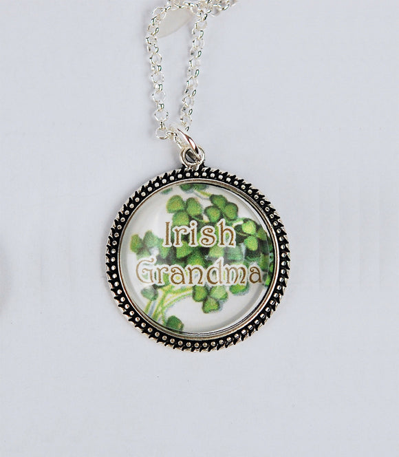 Pendant of antique silver bezel set sweet shamrocks captured under a dome of crystal clear glass with the words