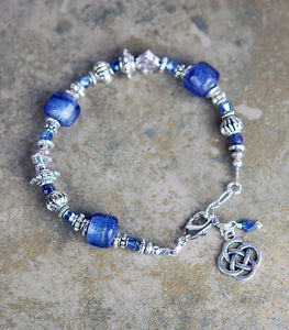 Bracelet with Sapphire Gemstones and Round Celtic Knot Drop