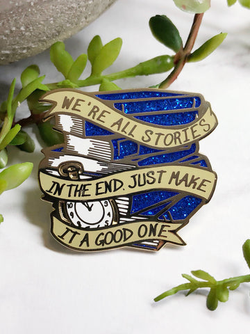 """We're All Stories"" Enamel Pin"