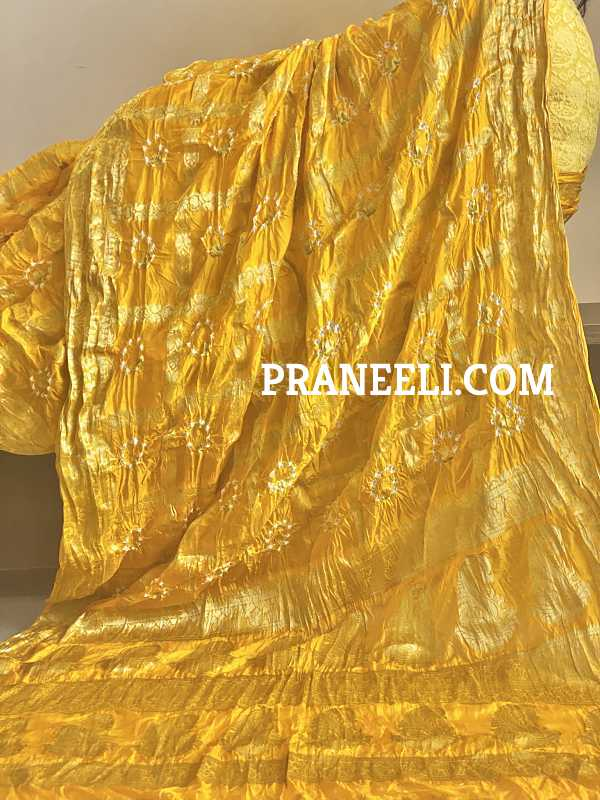Yellow Bandhani Heavy Zari Weaving Silk Saree With Gold Border and Gold Blouse Piece
