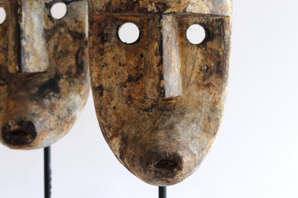 Timor mask on stand