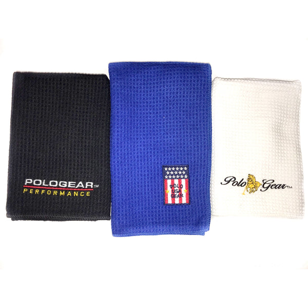 Set of three hand towels. A black towel is on the left, embroidered with a PoloGear Performance logo, a blue towel is in the middle with a PoloGear USA logo, and a white hand towel is on the right, embroidered with the classic PoloGear logo.
