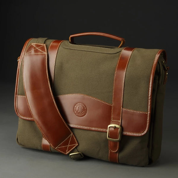 The beautiful and functional PoloGear Sheridan Leather COmputer Briefcase, featuring canvas and leather details. The padded shoulder strap is adjustable, and the brass hardware makes the bag a customer favorite.