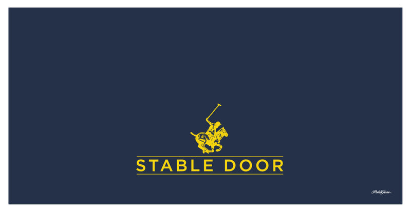 Deep blue rectangle representing a blanket with the PoloGear logo — a polo rider on a horse — above the words STABLE DOOR.