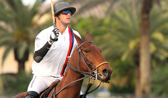 Polo Player with white shirt on horse