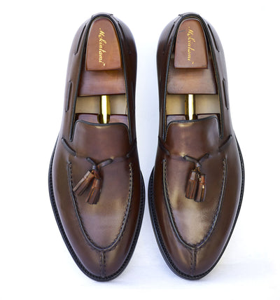 The deribe tassel loafer dark brown